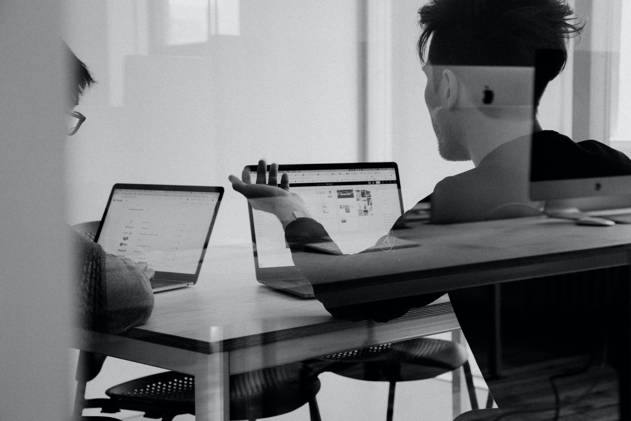 Two people working in front of computers